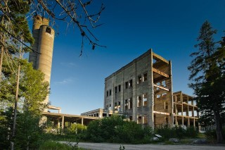 After the owners ran into financing problems, construction on the pulp and paper mill was haulted. Today the Mill still stands in its incomplete state, untouched since the 1920's.