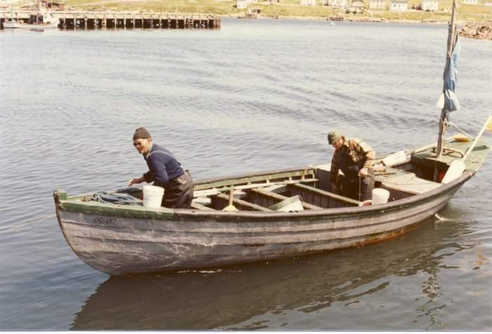 Fred Hollett and Angus Pike approaching their stage in a swamp boat. Photo taken in St. Lawrence, 1981.