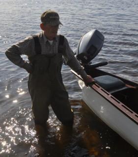 Basil Gillingham with his Gander River Boat at Gander Bay
