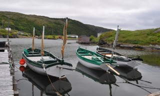 Three bully boats built by Lance at his wharf in Old Bonaventure. The boat closest to the wharf was launched in 2014, the middle is the oldest built in 2000, and the one furthest from the wharf was built in 2009.