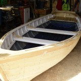 Edwin's boat is a modification of a catspaw dinghy blended with a traditional Newfoundland rodney.