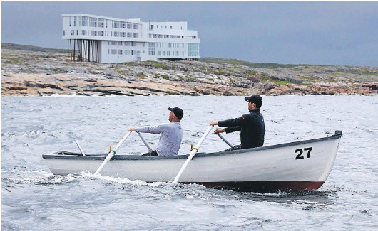 "Punt built by Frank Combden being rowed by Craig Whittle (left) and Chris Neary in the Great Fogo Island Punt Race ""To There and Back"", 2015."
