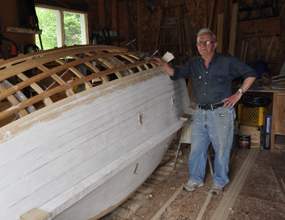 Sam Feltham with his punt under construction, 2012