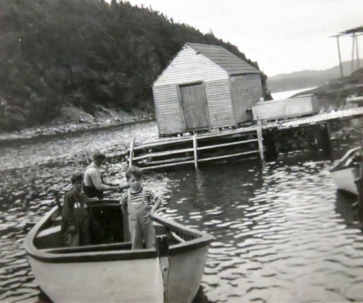 Calvie Meadus at stern in his motor boat